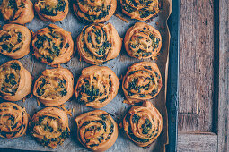 Vegan spinach buns with cheese on baking paper
