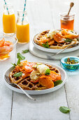Waffles with citrus fruits, honey, labneh and pistachio nuts