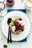 Waffles with rhubarb, berries and icing sugar