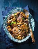 Chicken tajine with harissa, quinces and almonds