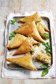 Samosas filled with peas, feta cheese, coriander, pepper and butter