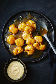 Salted caramel dumplings with vanilla sauce