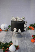 A Halloween cake with royal icing biscuit (red velvet)