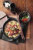 Wok-seared chilli plum steaks with corn fried rice