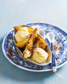 Vanilla ice cream with caramelized pears and malva pudding