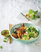 Crispy fried pork with rice and broccoli (Vietnam)