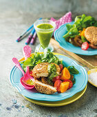 Sesame-crusted feta with salad and herbed pesto dressing