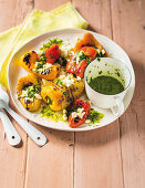 Grilled mini peppers with feta and mint dressing