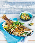Grilled fish filled with fennel and fruity pineapple salsa