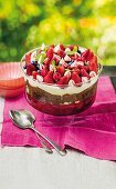Chocolate trifle with berries, cream and cream cheese