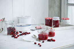 Cornelian cherry jam in storage jars