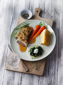 Saddle of lamb with carrots, spinach and potato pudding