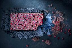 Vegan chocolate bar with pomegranate seeds