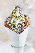 A bubble waffle with frozen yogurt, pistachios and striped candy canes for Christmas