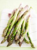 Green asparagus on tea towel