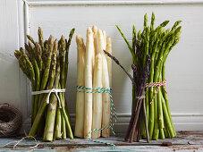 Various bundles of asparagus
