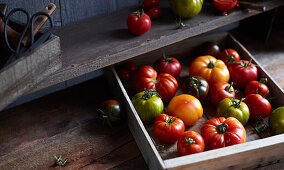 Red and green tomatoes in a crate