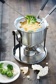 Cheese curry fondue with broccoli