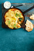 Indian style fish pie with a cauliflower and potato crust