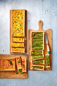 Three quiches: corn and chicken, asparagus, and bacon