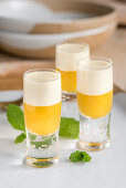 Curry soup in shot glasses