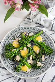 Broccolini with dressing and almond flakes