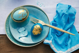 Blue Easter eggs decorated with gold leaf