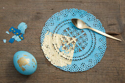 Easter egg and doily decorated in blue and gold