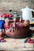 Chocolate cake with berries and chocolate macarons