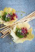 Wild garlic sorbet in Parmesan dishes