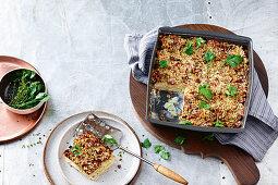 Parsnip, leek and potato gratin with pecan crumble