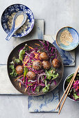 Sticky honey soy meatballs with sesame salad