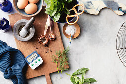 Enlighted cooking: a still life of various ingredients with a kitchen timer
