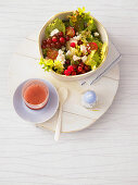 A colourful salad with feta, redcurrants and cassis vinaigrette