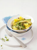 Potato salad with avocado, capers and cress