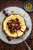 Pistachio and labne cheesecake with cherries and pistachios