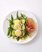 Carpaccio with eggs, rocket, cucumber and ham