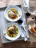 Duck pot au feu served with red wine and bread