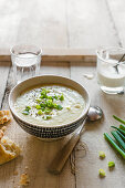 Spring onion and potato soup with cream and black pepper