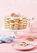 Fairy bread cake with cream cheese buttercream and biscuits on a cake stand