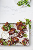 Spiced carrot and beetroot fritters with mint and apple yoghurt