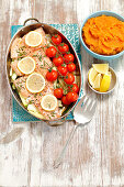 Oven-baked salmon trout with courgette and tomatoes served with pumpkin purée