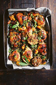 Apricot chicken with capers and couscous