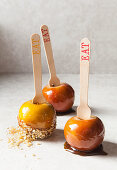 Three toffee apples with almond flakes