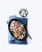 Sticky chicken sausages with apple slaw