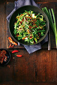 Bean, broccoli and sugar snap stir-fry with sesame brittle