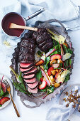 Red-wine poached beef with plum salad