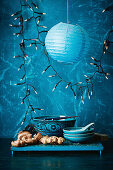 Asian dishes and vegetables, with fairy lights and a lantern