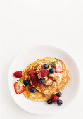 Oat pancakes with vanilla spiced ricotta and berries