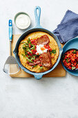Oven-baked chive pancake with tomato salsa